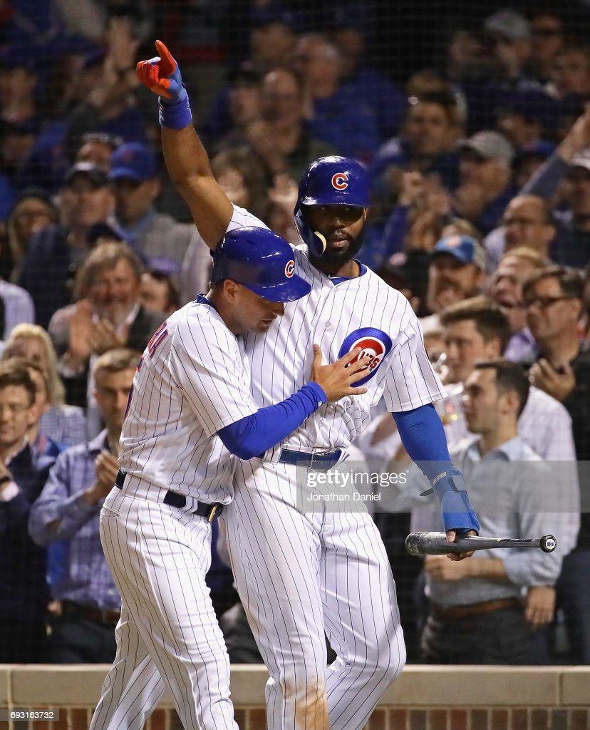 Albert SAlmora Jr. #5 (L) and Jason Heyward #22 of the Chicago Cubs celebrate after scoring runs in the 7th inning against the Miami Marlins at Wrigley Field on June 6, 2017 in Chicago, Illinois.