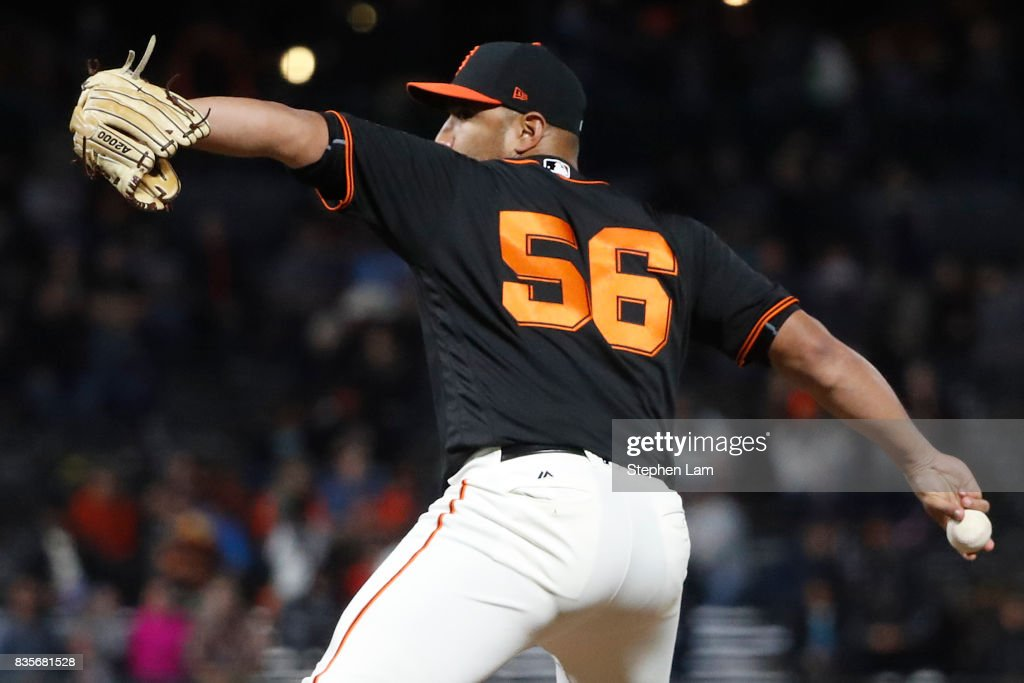 Albert Suarez #56 deliver a pitch during eighth inning against the Philadelphia Phillies at AT&T Park on August 19, 2017 in San Francisco, California. The Phillies defeated the Giants 12-9.