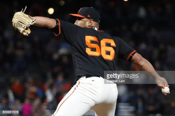 Albert Suarez deliver a pitch during eighth inning against the Philadelphia Phillies at ATT Park on August 19 2017 in San Francisco California The...