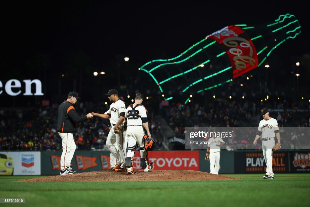 Albert Suarez #56 of the San Francisco Giants is taken out of the game by manager Bruce Bochy after giving up two runs to the Milwaukee Brewers in the seventh inning at AT&T Park on August 22, 2017 in San Francisco, California.