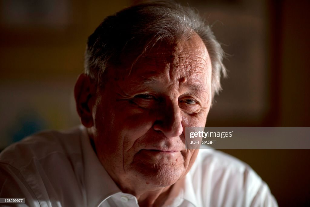 Albert Uderzo, French author and illustrator who launched the Asterix comics strip character in 1959 with author Rene Goscinny, poses in his office on October 2, 2012 in Neuilly-sur-Seine, outside Paris. Uderzo will release an comic strip book entitled 'L'integrale' on October 11, 2012, under the artistic direction of photographer Philippe Cauvin and Alain Duchene. AFP PHOTO JOEL SAGET