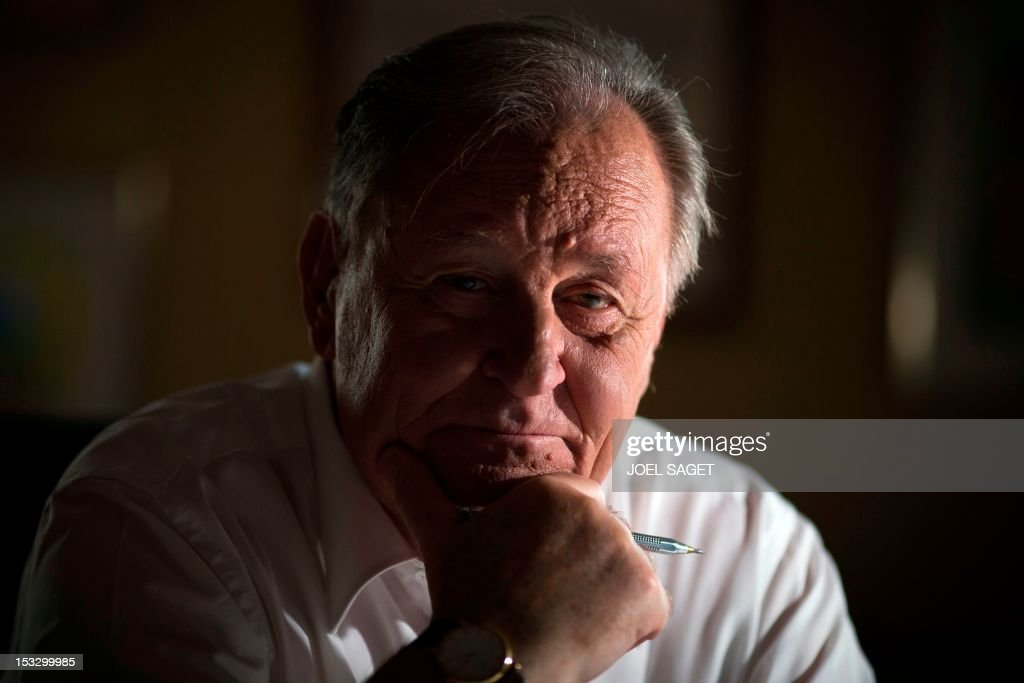 Albert Uderzo, French author and illustrator who launched the Asterix comics strip character in 1959 with author Rene Goscinny, poses in his office on October 2, 2012 in Neuilly-sur-Seine, outside Paris. Uderzo will release an comic strip book entitled 'L'integrale' on October 11, 2012, under the artistic direction of photographer Philippe Cauvin and Alain Duchene.