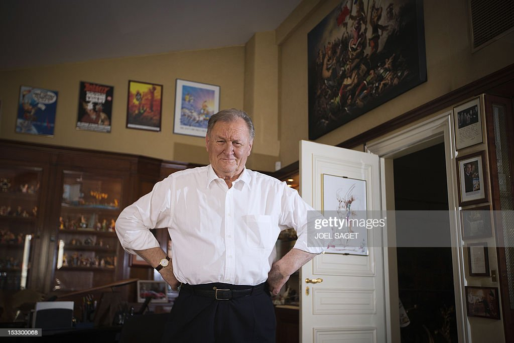 Albert Uderzo, French author and illustrator who launched the Asterix comics strip character in 1959 with author Rene Goscinny, poses in his office at his home on October 2, 2012 in Neuilly-sur-Seine, outside Paris. Uderzo will release an comic strip book entitled 'L'integrale' on October 11, 2012, under the artistic direction of photographer Philippe Cauvin and Alain Duchene.