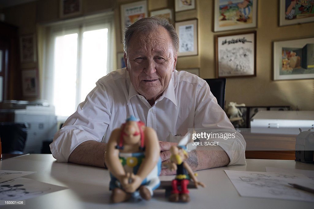 Albert Uderzo, French author and illustrator who launched the Asterix comics strip character in 1959 with author Rene Goscinny, poses with the statues of his characters Asterix (R) and Obelix (L), in his office on October 2, 2012 in Neuilly-sur-Seine, outside Paris. Uderzo will release an comic strip book entitled 'L'integrale' on October 11, 2012, under the artistic direction of photographer Philippe Cauvin and Alain Duchene.