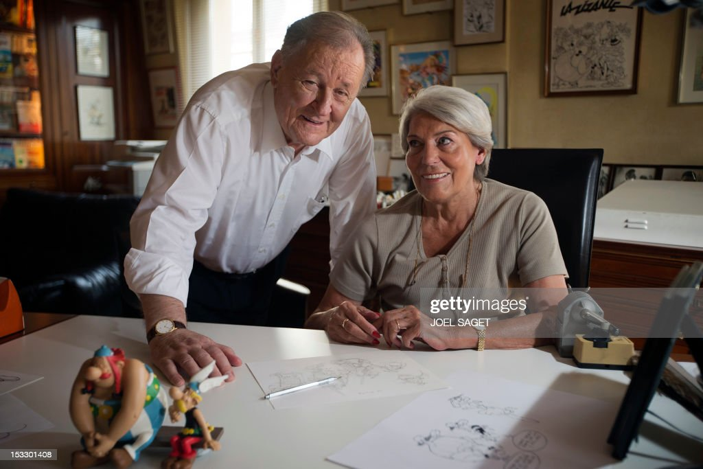 Albert Uderzo, French author and illustrator who launched the Asterix comics strip character in 1959 with author Rene Goscinny, speaks with his wife Ada beside the statues of his characters Asterix (R) and Obelix (L), in his office on October 2, 2012 in Neuilly-sur-Seine, outside Paris. Uderzo will release an comic strip book entitled 'L'integrale' on October 11, 2012, under the artistic direction of photographer Philippe Cauvin and Alain Duchene.