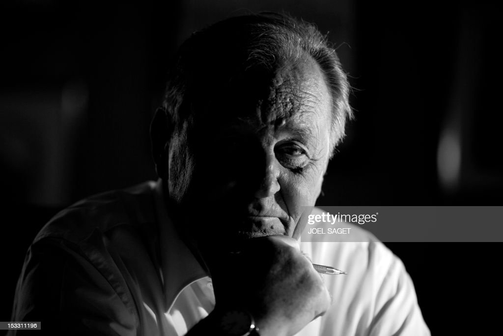 Albert Uderzo, French author and illustrator who launched the Asterix comics strip character in 1959 with author Rene Goscinny, poses in his office at his home, on October 2, 2012 in Neuilly-sur-Seine, outside Paris. Uderzo will release a comic strip book entitled 'L'integrale' on October 11, 2012, under the artistic direction of photographer Philippe Cauvin and Alain Duchene.