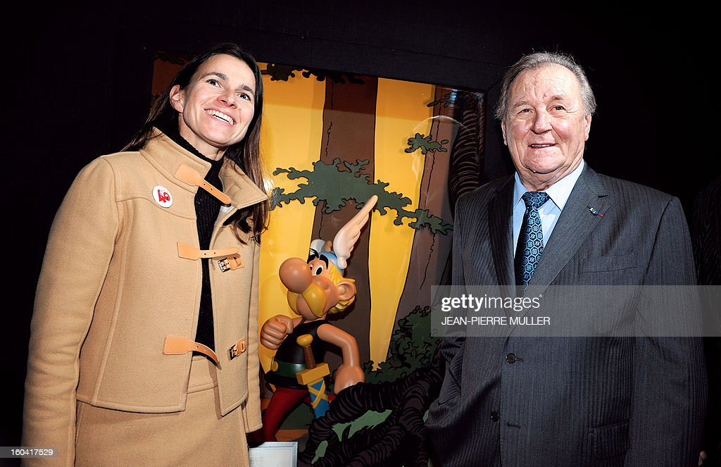 Albert Uderzo (R), French author and illustrator who launched the Asterix comics strip character in 1959 with author Rene Goscinny poses with France's Culture Minister Aurelie Filippetti, on January 31, 2013 on the opening day of the 40th edition of the Angouleme International Comics Festival in Angouleme, southwestern France.