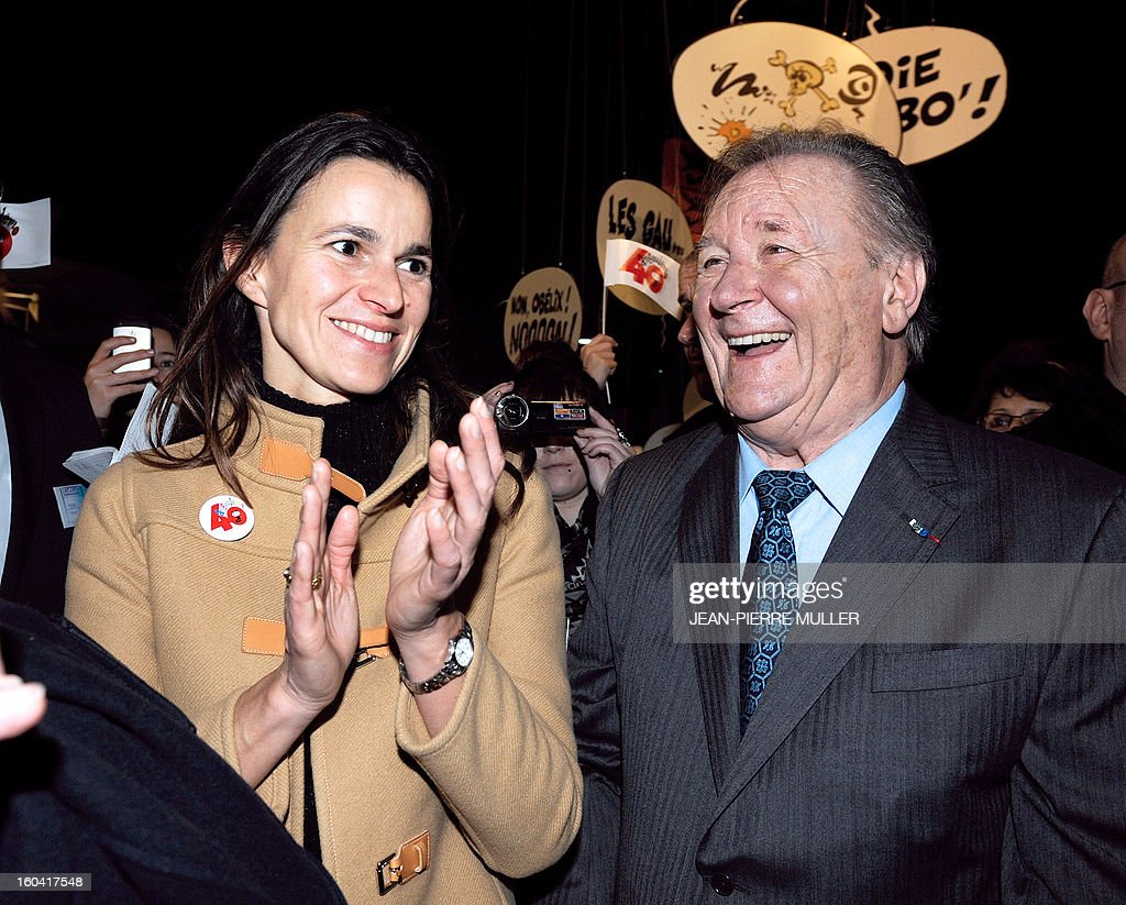 Albert Uderzo (R), French author and illustrator who launched the Asterix comics strip character in 1959 with author Rene Goscinny shares a laugh with France's Culture Minister Aurelie Filippetti, on January 31, 2013 on the opening day of the 40th edition of the Angouleme International Comics Festival in Angouleme, southwestern France. AFP PHOTO / JEAN-PIERRE MULLER