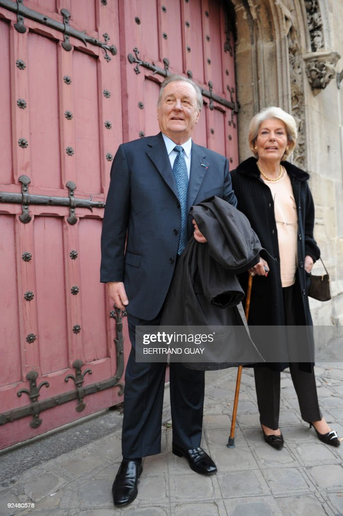 Albert Uderzo, French author and illustrator who launched the Asterix comics strip character with author Rene Goscinny, poses next to his wife on October 27, 2009, in front of the Cluny Museum in Paris, where will be held an exhibition on Asterix. The exhibition, marking the 50th anniversary of the character's first appearance in 1959, will be held from October 28, 2009 until January 1, 2010. AFP PHOTO / BERTRAND GUAY