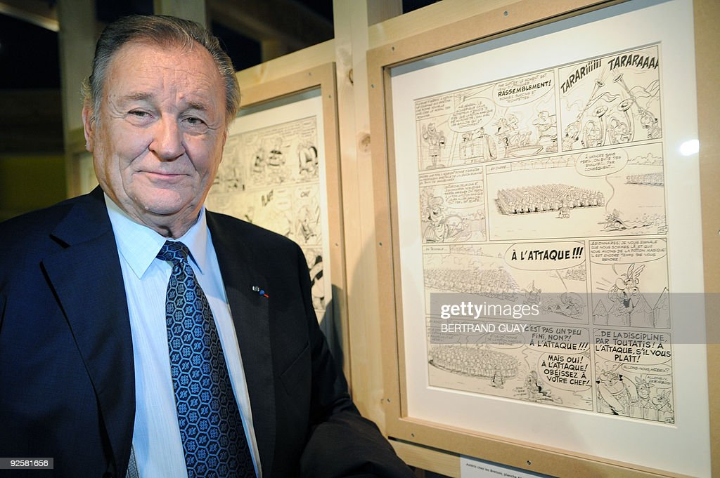 USE - Albert Uderzo, French author and illustrator who launched the Asterix comics strip character with author Rene Goscinny, poses on October 27, 2009, next to Asterix cartoon sketches displayed at the Cluny Museum in Paris. The exhibition, marking the 50th anniversary of the character's first appearance in 1959, will be held from October 28, 2009 until January 1, 2010.