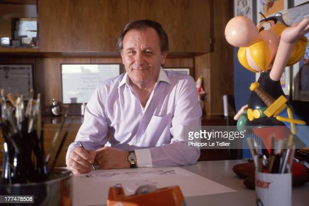 Albert Uderzo the creator of Asterix and Obelix poses with his characters Asterix is thirty years old Albert Uderzo le createur d'Asterix et d'Obelix...