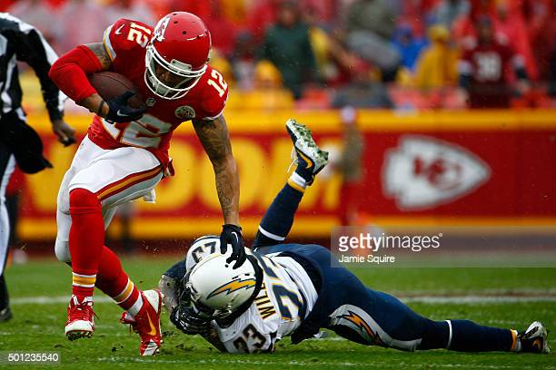 Albert Wilson of the Kansas City Chiefs avoids the tackle of Steve Williams of the San Diego Chargers on his way to a touchdown at Arrowhead Stadium...