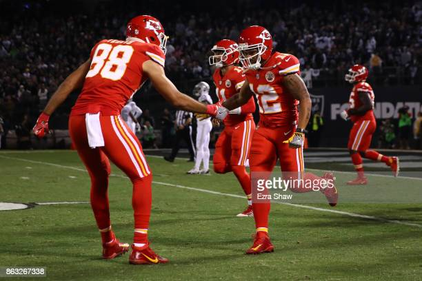 Albert Wilson of the Kansas City Chiefs celebrates with Ross Travis after a 63yard touchdown catch against the Oakland Raiders during their NFL game...