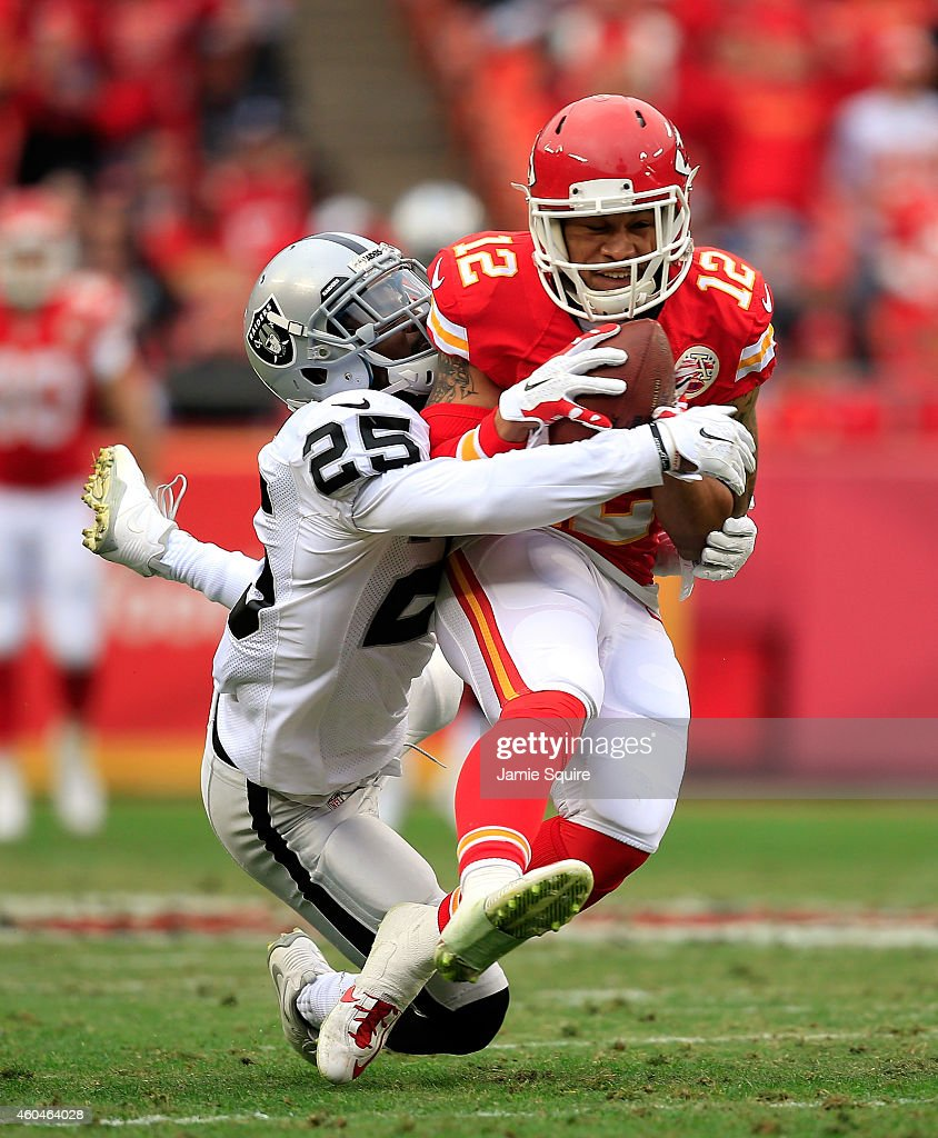 Albert Wilson of the Kansas City Chiefs makes a 48yard completion against DJ Hayden of the Oakland Raiders during the first quarter at Arrowhead...