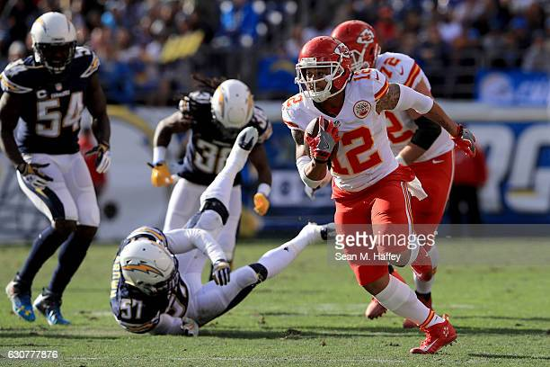Albert Wilson of the Kansas City Chiefs runs past Melvin Ingram and Jatavis Brown of the San Diego Chargers during the first half of a game at...