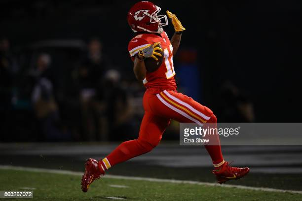 Albert Wilson of the Kansas City Chiefs scores on a 63yard touchdown catch against the Oakland Raiders during their NFL game at OaklandAlameda County...