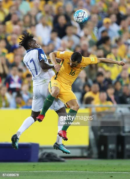 Alberth Elis of Honduras and Aziz Behich of Australia compete for a header during the 2018 FIFA World Cup Qualifiers Leg 2 match between the...