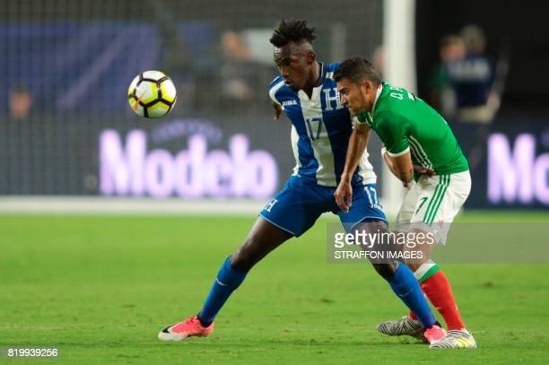 Alberth Elis of Honduras and Orbelin Pineda of Mexico fight for the ball during the CONCACAF Gold Cup 2017 quarterfinal match between Mexico and...