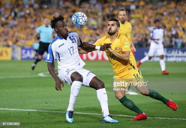 Alberth Elis of Honduras is challenged by Aziz Behich of Australia during the 2018 FIFA World Cup Qualifiers Leg 2 match between the Australian...