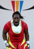 Albertine Um of Cameroon celebrates during the Women's Weighlifting 75kg Group A Final at Scottish Exhibition And Conference Centre during day seven...