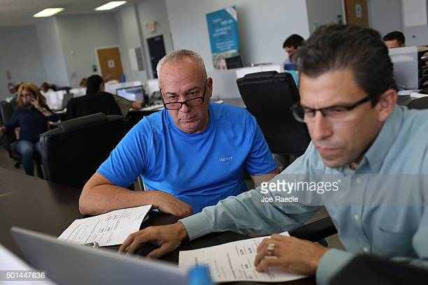 Alberto Abin an insurance advisor with UniVista Insurance company helps Carlos Rodriguez shop for a health plan under the Affordable Care Act also...