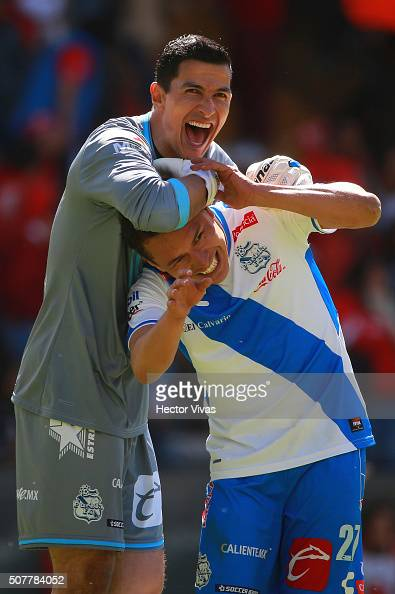 Alberto Acosta of Puebla celebrates with his teammate Fabián Villaseñor after scoring the tying goal during the fourth round match between Toluca and...