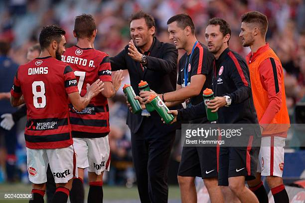 Alberto Aguilar of the Wanderers celebrates scoring a goal with Tony Popovic coach of the Wanderers during the round 12 ALeague match between the...