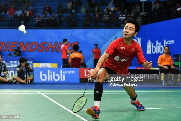 Alberto Alvin Yulianto of Indonesia competes against Bai Yupeng of China during Men Single qualification round of the BWF World Junior Badminton...