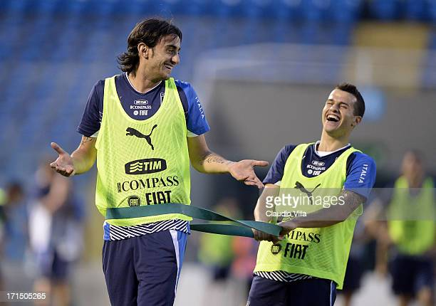 Alberto Aquilani and Sebastian Giovinco joke during an Italy training session at Estadio Presidente Vargas on June 25 2013 in Fortaleza Brazil