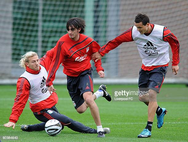 Alberto Aquilani goes past Andriy Voronin and Phillipp Degan during a training session at Melwood Training Ground on October 27 2009 in Liverpool...