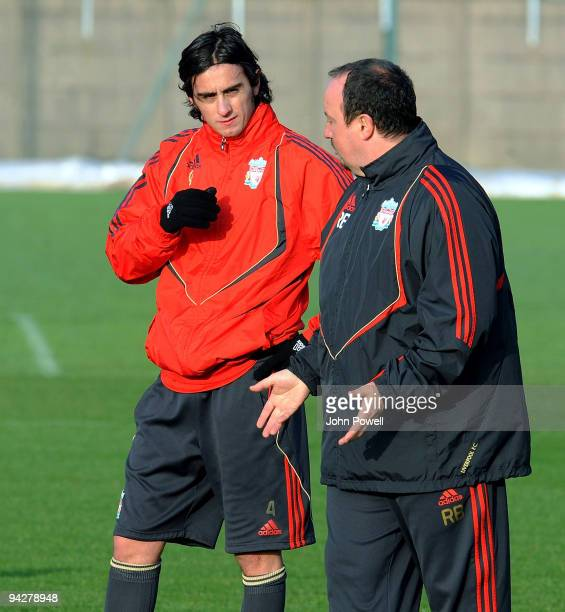 Alberto Aquilani has a chat with Rafael Benitez manager of Liverpool during a team training session at Melwood training ground on December 11 2009 in...