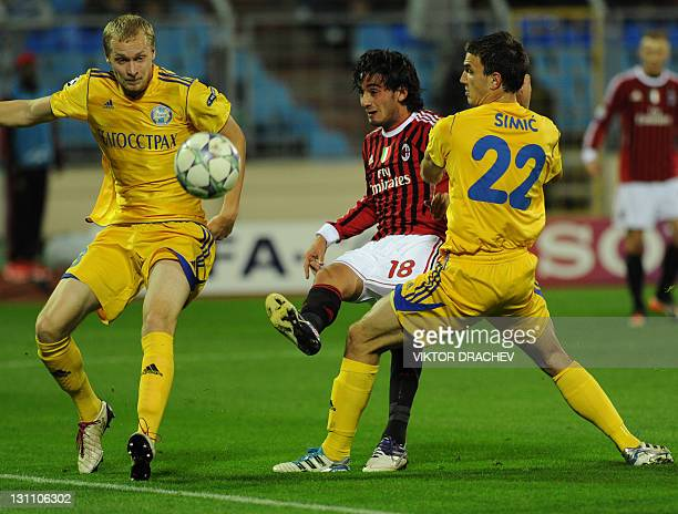 Alberto Aquilani of AC Milan vies for the ball with Marco Simic and Maksim Bordachev of Bate Borisov during their UEFA Champions League Group H...