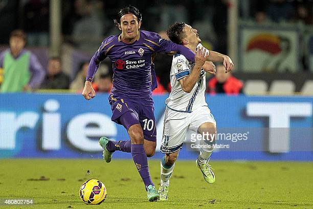 Alberto Aquilani of ACF Fiorentina battles for the ball with Mario Rui of Empoli FC during the Serie A match betweeen ACF Fiorentina and Empoli FC at...
