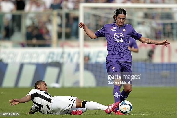 Alberto Aquilani of ACF Fiorentina fights for the ball with Gabriel Silva of Udinese Calcio during the Serie A match between ACF Fiorentina and...