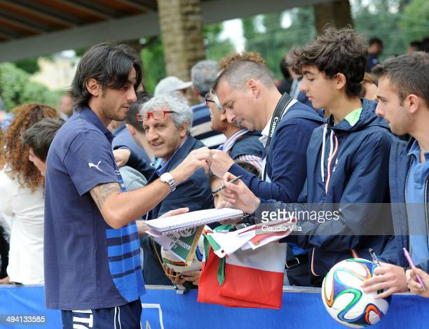 Alberto Aquilani of Italy sign autographs for fan after a training session at Coverciano on May 28 2014 in Florence Italy