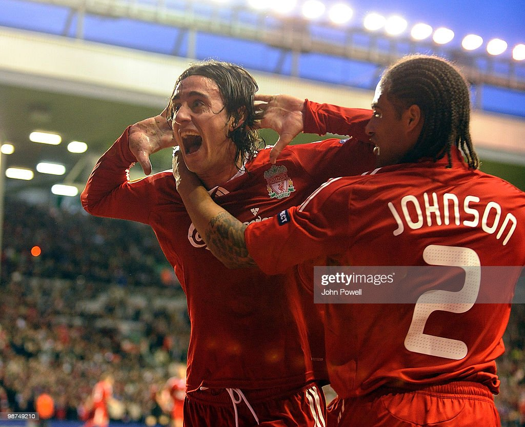 Alberto Aquilani of Liverpool celebrates after scoring the opening goal with Glen Johnson during the UEFA Europa League Semi-Finals Second Leg match between Liverpool FC and Atletico Madrid at Anfield on April 29, 2010 in Liverpool, England.