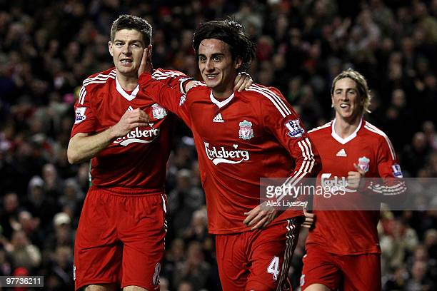 Alberto Aquilani of Liverpool celebrates scoring his team's third goal with his team mates during the Barclays Premier League match between Liverpool...