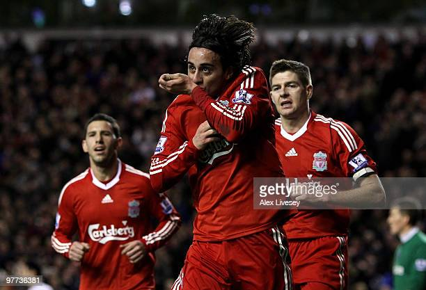 Alberto Aquilani of Liverpool celebrates scoring his team's third goal during the Barclays Premier League match between Liverpool and Portsmouth at...