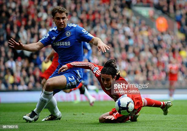 Alberto Aquilani of Liverpool clashes with Branislav Ivanovic of Chelsea during the Barclays Premier League match between Liverpool and Chelsea at...
