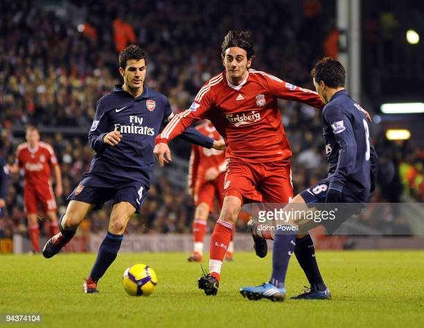 Alberto Aquilani of Liverpool competes with Cesc Fabregas of Arsenal during the Barclays Premier League match between Liverpool and Arsenal at...