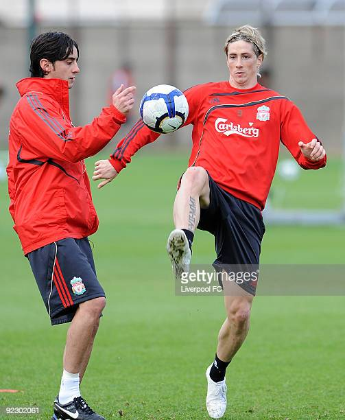Alberto Aquilani of Liverpool competes with Fernando Torres of Liverpool during a Liverpool FC training session at the team's Melwood Training ground...