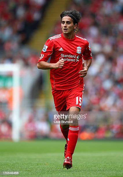 Alberto Aquilani of Liverpool in action during the pre season friendly match between Liverpool and Valencia at Anfield on August 6 2011 in Liverpool...