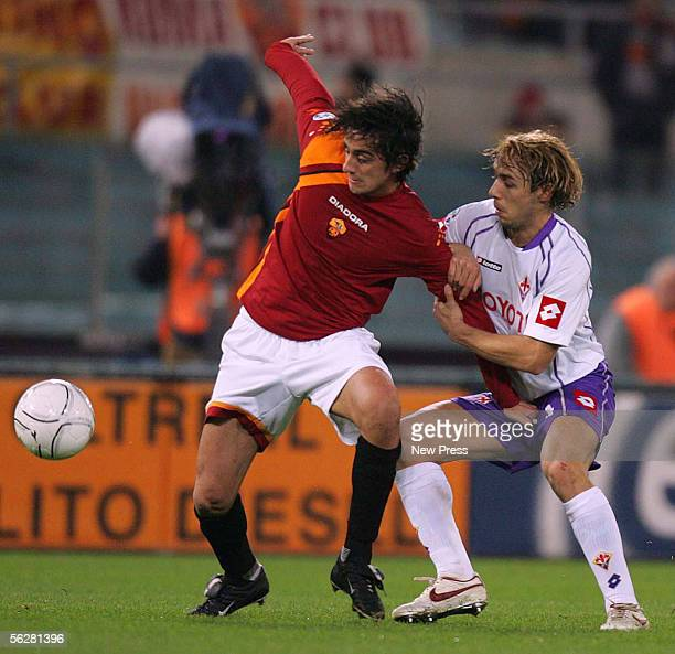 Alberto Aquilani of Roma and Marco Donadel of Fiorentina in action during the Serie A match between AS Roma and Fiorentina at the Stadio Olimpico on...