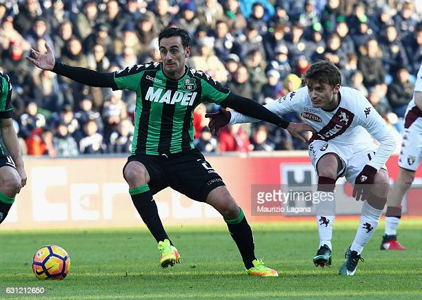 Alberto Aquilani of Sassuolo competes for the ball with Adem Ljajic of Torino during the Serie A match between US Sassuolo and FC Torino at Mapei...