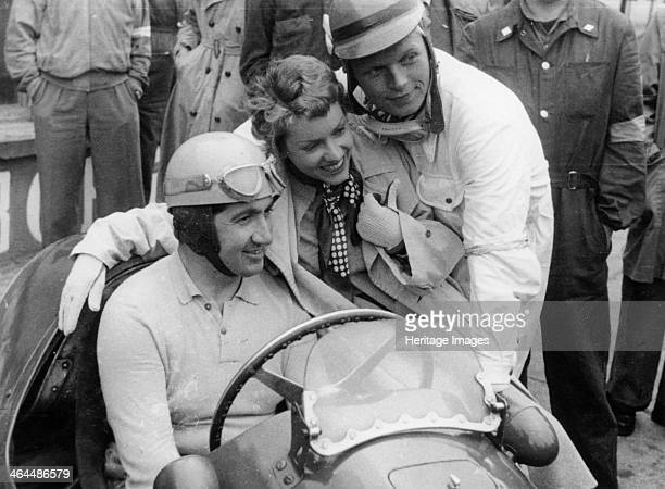Alberto Ascari in a Ferrari 1953 Being photographed with a female fan and a young driver Enzo Ferrari signed Ascari up in 1949 and he won many races...
