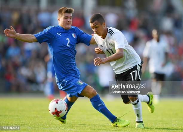 Alberto Barazzetta of Italy challenges Oliver Batista Meier of Germany during the Four Nations Tournament match between U17 Germany and U17 Italy at...