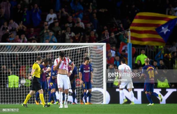 Alberto Botia of Olympiacos reacts after Lucas Digne of Barcelona scores his sides third goal of the game during the UEFA Champions League group D...