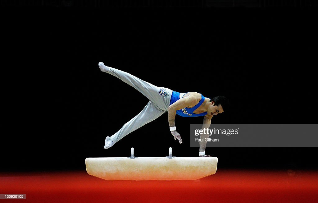 <a gi-track='captionPersonalityLinkClicked' href=/galleries/search?phrase=Alberto+Busnari&family=editorial&specificpeople=2958236 ng-click='$event.stopPropagation()'>Alberto Busnari</a> of Italy competes on the Pommel Horse during the Men's Artistic Gymnastics Individual Olympic Qualification Final round at North Greenwich Arena on January 12, 2012 in London, England.