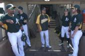 Alberto Callaspo Daric Barton Coco Crisp Billy Burns and Josh Reddick of the Oakland Athletics stand in the dugout prior to a spring training game...