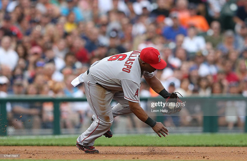 <a gi-track='captionPersonalityLinkClicked' href=/galleries/search?phrase=Alberto+Callaspo&family=editorial&specificpeople=835933 ng-click='$event.stopPropagation()'>Alberto Callaspo</a> #6 of the Los Angeles Angels of Anaheim fields the ground ball from <a gi-track='captionPersonalityLinkClicked' href=/galleries/search?phrase=Jhonny+Peralta&family=editorial&specificpeople=213286 ng-click='$event.stopPropagation()'>Jhonny Peralta</a> #27 of the Detroit Tigers during the second inning of the game at Comerica Park on June 25, 2013 in Detroit, Michigan. The Angels defeated the 14-8.
